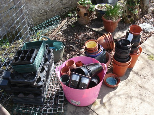 A tidy pile of pots ready for washing