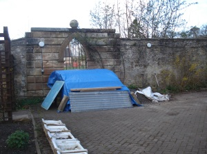 "The wood is under the blue tarpaulin, the dubious ""sinks"" can be seen in the foreground."